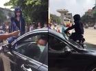 Cô gái đánh ghen nhảy lên nắp capo, chồng và nhân tình cố thủ trong xe