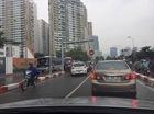 Hai chiếc taxi ngang nhiên đi ngược chiều tại cầu vượt Hoàng Minh Giám