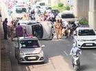 Tránh xe máy chạy sai làn, taxi lật nghiêng trong hầm đường bộ Nguyễn Trãi