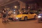 Hà Nội: Nữ tài xế cầm lái Porsche 911 Carrera va chạm cùng xe máy