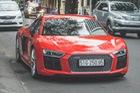 Đông Nhi cầm lái siêu xe Audi trên phố Sài Gòn