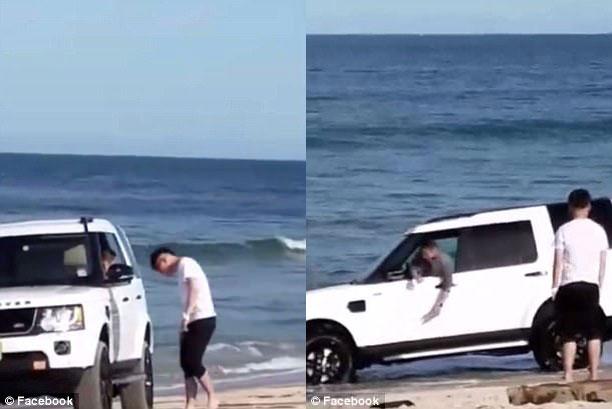 Đỗ trên bờ biển, SUV hạng sang Land Rover suýt bị sóng nhấn chìm - Ảnh 1.