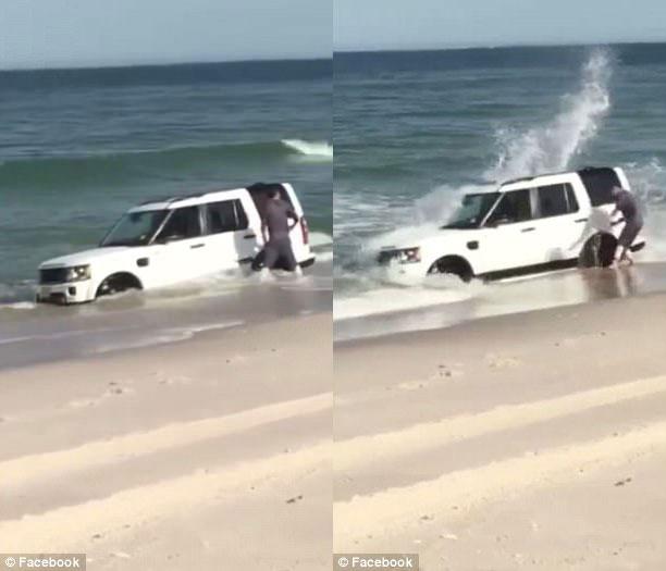Đỗ trên bờ biển, SUV hạng sang Land Rover suýt bị sóng nhấn chìm - Ảnh 3.