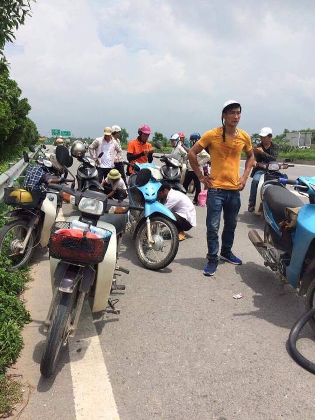 Hàng loạt xe dính bẫy đinh trên cao tốc Hà Nội - Bắc Giang, tài xế khóc dở mếu dở giữa trời nắng - Ảnh 1.