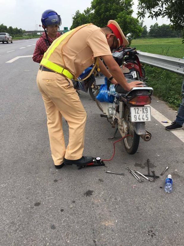 Hàng loạt xe dính bẫy đinh trên cao tốc Hà Nội - Bắc Giang, tài xế khóc dở mếu dở giữa trời nắng - Ảnh 9.