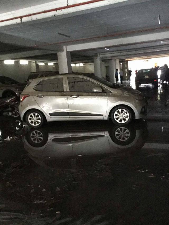 Mưa lớn kéo dài tại Bà Rịa - Vũng Tàu khiến hàng loạt ô tô chết đuối trong hầm chung cư - Ảnh 4.