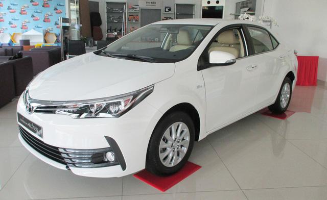 Khuyến mại nối tiếp, giá xe Toyota lại giảm sâu, tạo đáy mới - Ảnh 1.
