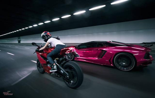 Mỹ nữ lái Ducati 899 Panigale thách đấu Lamborghini Aventador - Ảnh 11.