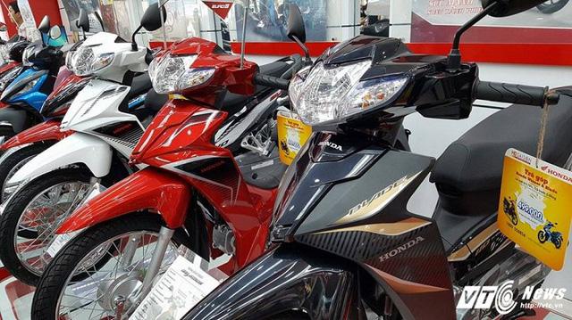 Giá xe máy Honda đang rơi tự do - Ảnh 1.