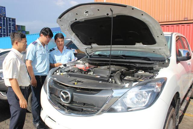 Theo thuế giảm, ô tô ùn ùn nhập khẩu qua cảng TP.HCM - Ảnh 6.