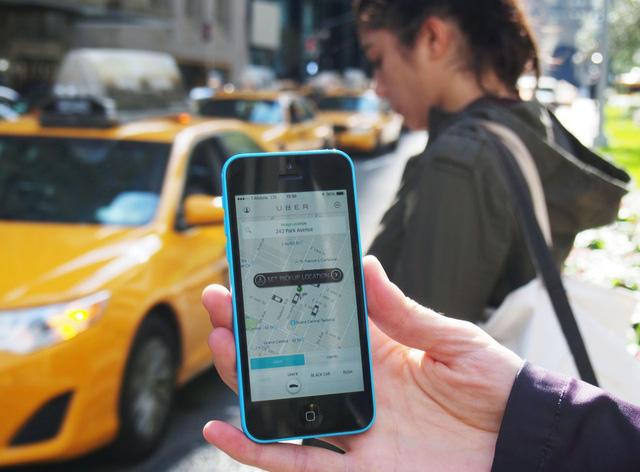 Uber lấn sân sang chia sẻ xe máy, bán vé xe bus - Ảnh 1.