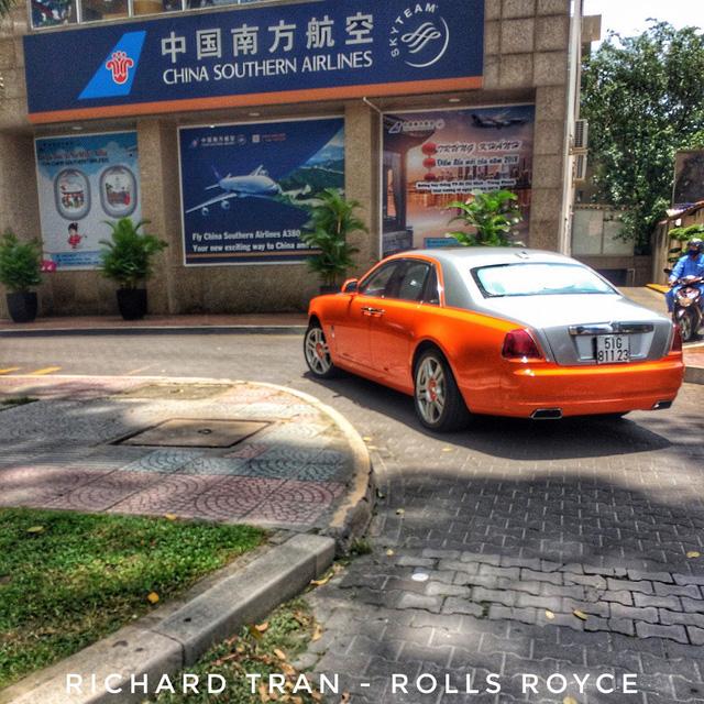 Rolls-Royce Ghost màu cam đầu tiên Việt Nam của đại gia Sài Gòn - Ảnh 5.