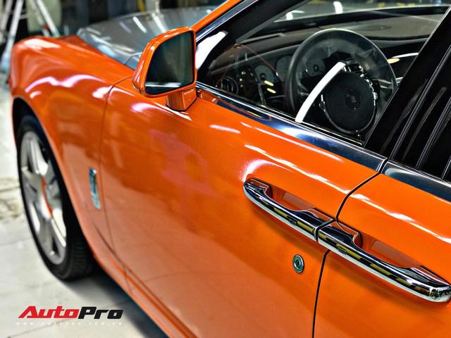 Rolls-Royce Ghost màu cam đầu tiên Việt Nam của đại gia Sài Gòn - Ảnh 3.