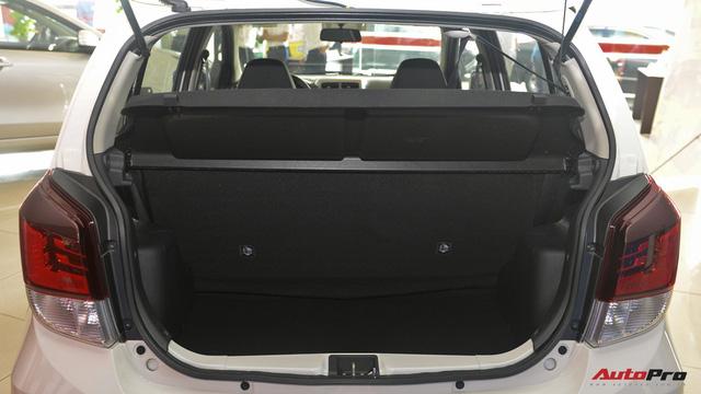 Đánh giá nhanh Toyota Wigo: Thua trang bị, thắng thương hiệu - Ảnh 11.