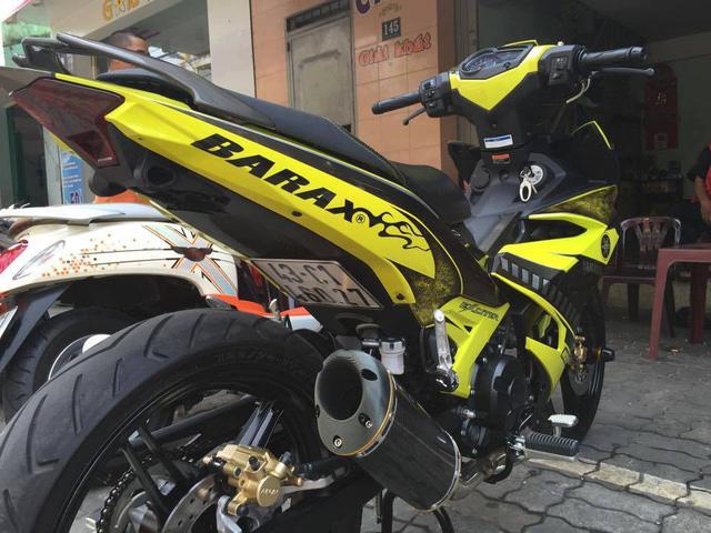 Xe máy gắn biển số đút gầm sẽ bị phạt tiền đến 2 triệu đồng - Ảnh 1.