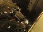 Sài Gòn: Taxi mất lái, tông vào rào chắn, lao xuống cầu chữ Y