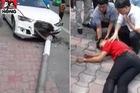 Xế hộp tông đổ cột điện, rơi trúng người đi đường