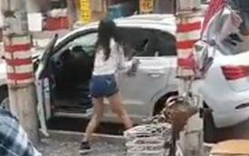 """Người phụ nữ đập phá Audi Q3 mới toanh vì """"xe quá nhỏ"""""""
