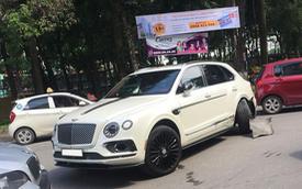Bentley Bentayga độ Mansory độc nhất Việt Nam gãy bánh sau pha va chạm với taxi